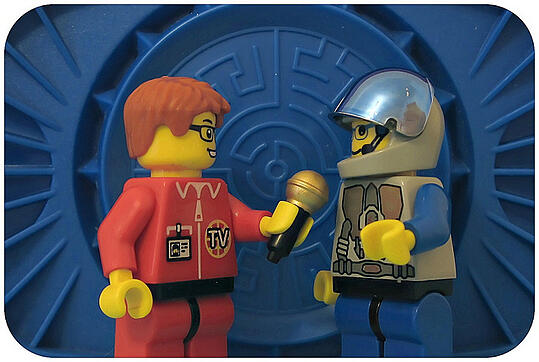 Lego reporter conducting an interview